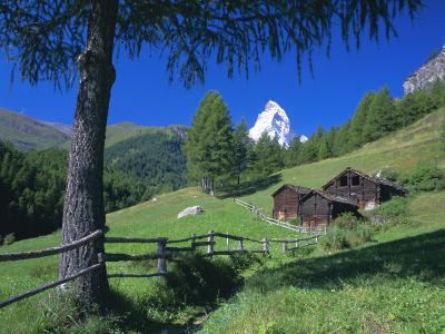 The Matterhorn Towering Above Green Pastures and Wooden Huts, Swiss Alps, Switzerland-Ruth Tomlinson-Photographic Print