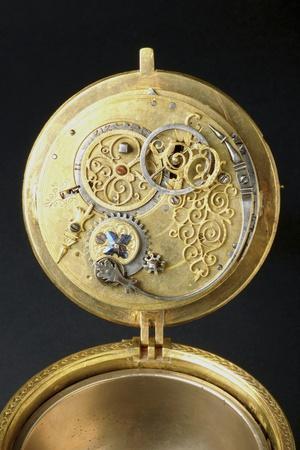 https://imgc.artprintimages.com/img/print/the-mechanism-of-crucifix-shaped-gilt-brass-clock_u-l-pv0l5h0.jpg?p=0
