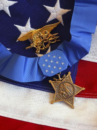 The Medal of Honor Rests On a Flag Beside a SEAL Trident-Stocktrek Images-Photographic Print