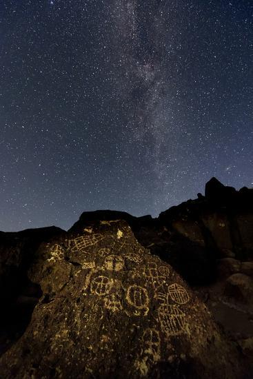 The Milky Way Above an Ancient Native American Petroglyph in the Owens Valley of Sierra-Babak Tafreshi-Photographic Print