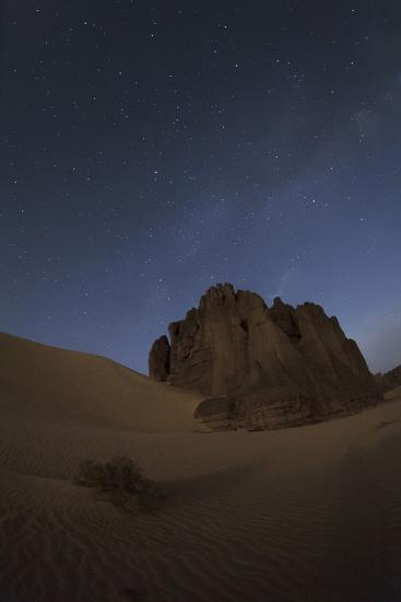 The Milky Way Appears Above Sandstone Cliffs in Tassili National Park-Babak Tafreshi-Photographic Print