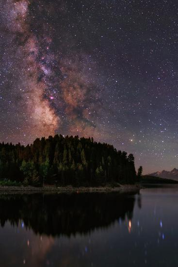 The Milky Way Appears in Constellation Scorpius and Sagittarius over the The Jackson Lake Dam-Babak Tafreshi-Photographic Print