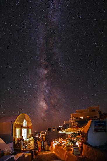 The Milky Way from Scorpius and Sagittarius, to Cygnus at Top, over Candle-Lit Restaurants-Babak Tafreshi-Photographic Print