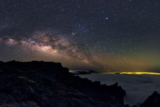 The Milky Way Rising Above La Palma Island  Clouds Fill Volcanic Crater,  Caldera De La Taburiente Photographic Print by Babak Tafreshi | Art com