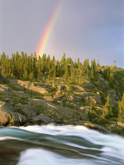 The Mist-Filled Tides of Clearwater River Wash against a Rocky Shore Where  a Ra Inbow Takes Form Photographic Print by Barry Tessman | Art com