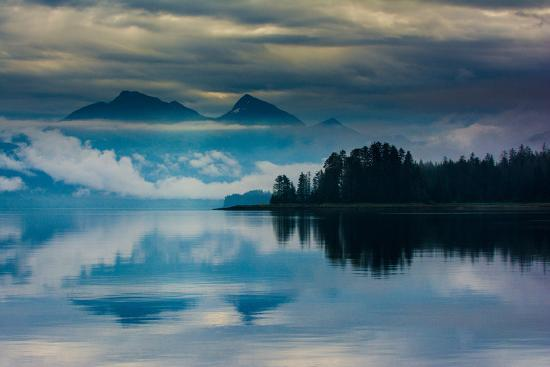 The misty mountains and calm waters of the Tongass National Forest, Southeast Alaska, USA-Mark A Johnson-Photographic Print