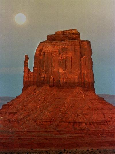 The Moon Rises Over a Butte Known at the Mitten at Monument Valley Navajo Tribal Park--Photographic Print