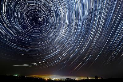 The Motion of Stars around Pole Star in the Night City- AlexussK-Photographic Print