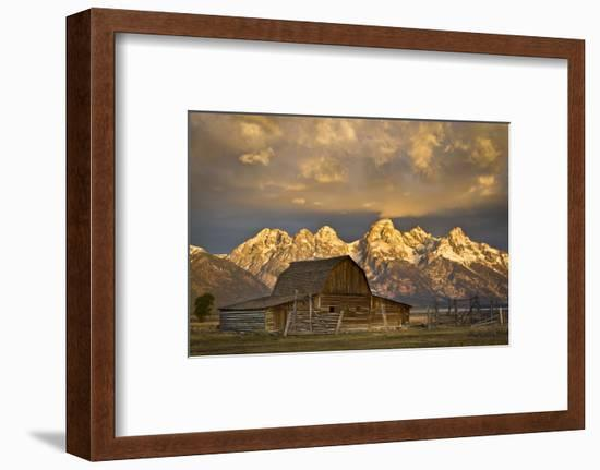 The Moulton Barn on Mormon Row Stands before a Fiery Sunrise in Grand Teton National Park, Wyoming-Mike Cavaroc-Framed Photographic Print