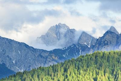 The Mount Sernio Emerges from the Clouds and Stands with Majesty Abiove the Green Woods, Alpi Carni-Gabriele Bano-Photographic Print