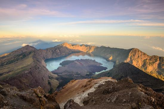 The Mt. Rinjani Crater and a Shadow Cast from the Peak at Sunrise-John Crux-Photographic Print