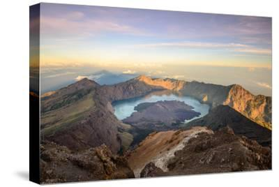 The Mt. Rinjani Crater and a Shadow Cast from the Peak at Sunrise-John Crux-Stretched Canvas Print
