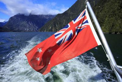 The New Zealand Maritime Flag Flies Off Stern of a Cruise Boat , South Island of New Zealand-Paul Dymond-Photographic Print