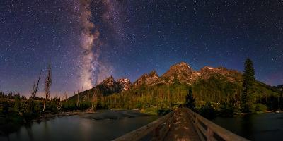 The Night Sky over a Bridge in Grand Teton National Park-Babak Tafreshi-Photographic Print