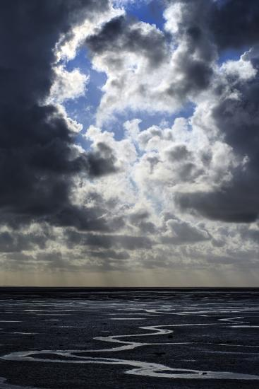 The Ocean Floor at Low Tide in Mont Saint Michel Bay. Heavy Clouds Above and Virga in the Distance-Babak Tafreshi-Photographic Print