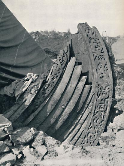 'The Oseberg ship in the mound, showing the carving on stem and railing', 1935-Unknown-Photographic Print