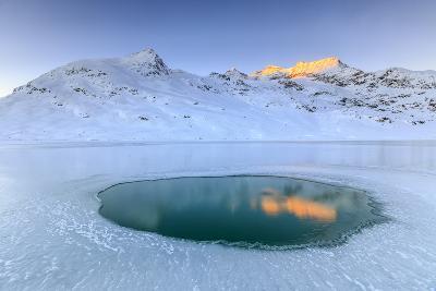 The Piz Cambrena Illuminated by the Sun Reflecting in a Pool Surrounded by Ice at the Bernina-Roberto Moiola-Photographic Print