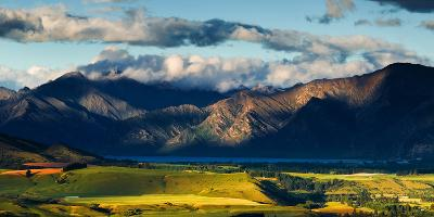 The Plains and Lakes of Otago Region Framed by Cloud Capped Mountains, Otago, South Island-Garry Ridsdale-Photographic Print