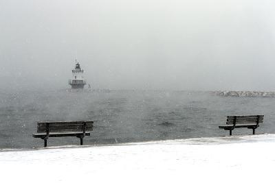 The Portland Breakwater Light Lighthouse Is Just Visible on a Snowy Winter's Day-Robbie George-Photographic Print