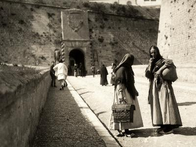 The Ramp Which Leads to the Old City in Ibiza, with Two Women in the Foreground--Photographic Print