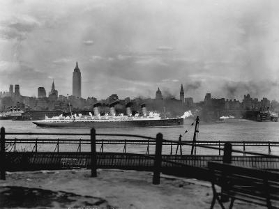 The S.S. Mauretania and New York City Skyline--Photographic Print
