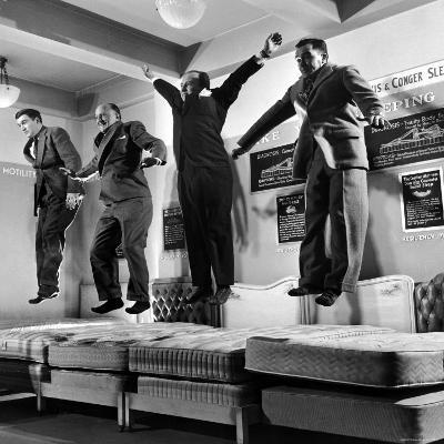 The Salesmen Showing How Not to Test a Bed at Lewis and Conger-George Silk-Photographic Print