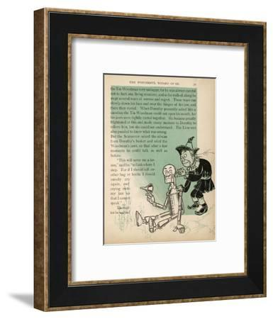 The Scarecrow Oils the Tin Woodman's Jaws after His Tears Cause Them to Rust--Framed Giclee Print