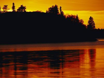 The Setting Sun Casts an Orange Glow Over Manitoba's White Lake-Raymond Gehman-Photographic Print