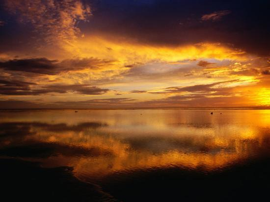 The Setting Sun Casts Light on Dark Clouds and Sea, Cook Islands-Peter Hendrie-Photographic Print