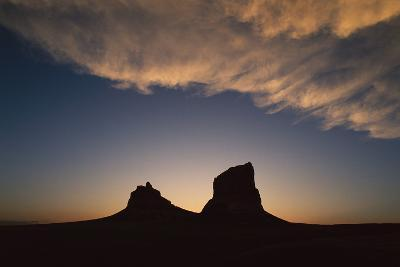 The Setting Sun Forms a Silhouette Courthouse and Jail Rocks-Michael Forsberg-Photographic Print