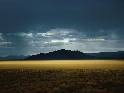 The Setting Sun Permeates Rain Clouds to Brighten Black Rock Desert, Nevada-James P^ Blair-Photographic Print