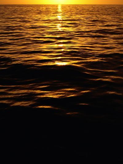 The Setting Sun Reflects onto the Waves-Heather Perry-Photographic Print