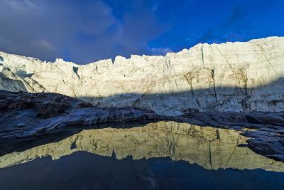 The Setting Sun Reflects the Sheer Ice Cliff of a Glacier Fracture Zone in a Pond-Jason Edwards-Photographic Print