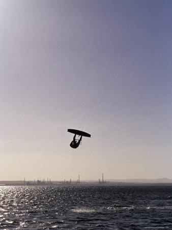 https://imgc.artprintimages.com/img/print/the-silhouette-of-a-person-kite-surfing-in-a-choppy-windswept-bay-australia_u-l-p2ylhl0.jpg?p=0