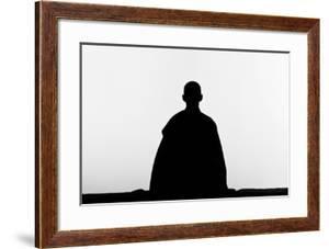 The Silhouette of a Zen Buddhist Nun Practicing Zen-Meditation (Zazen)