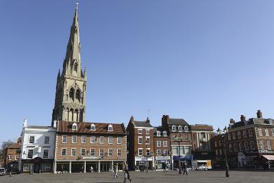 The Spire of St. Mary Magdalene Church Rises over Building on the Market Square-Stuart Forster-Photographic Print