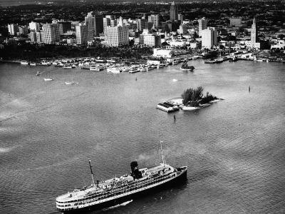 The SS Florida Goes to Sea, with Downtown Miami in the Background, 1953--Photographic Print