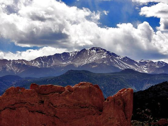 The Sun Breaks Through the Clouds to Highlight the Summit of Pikes Peak--Photographic Print