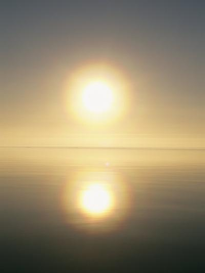 The Sun Casts its Reflection Upon the Water-Norbert Rosing-Photographic Print