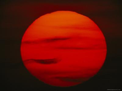 The Sun, Glowing Red as It Sets--Photographic Print