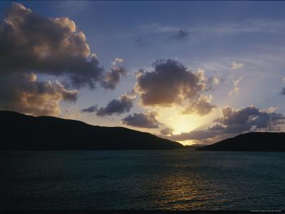 The Sun Hides Behind a Cloud Low in the Sky-Todd Gipstein-Photographic Print