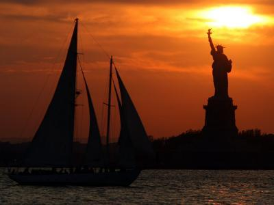 The Sun Sets Behind the Statue of Liberty on the Longest Day of the Year--Photographic Print