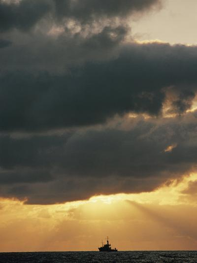 The Sun Shines Through the Clouds over the Atlantic Ocean-Emory Kristof-Photographic Print