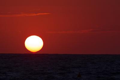 The Sun Sinks into the Atlantic Ocean, Off the Coast of Normandy, France-Babak Tafreshi-Photographic Print