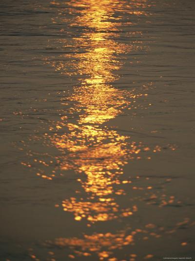 The Sunset Casts an Orange Hue on the Mackenzie River-Raymond Gehman-Photographic Print