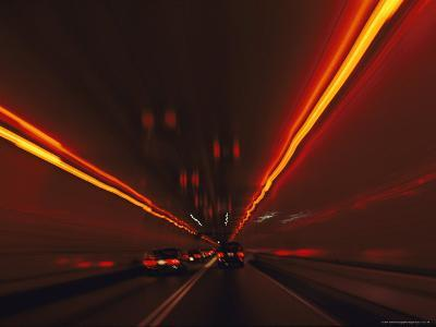 The Taillights of Cars Reflected on the Walls and Ceiling of a Tunnel-Medford Taylor-Photographic Print