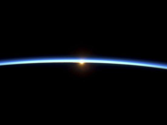 The Thin Line of Earth's Atmosphere and the Setting Sun--Photographic Print