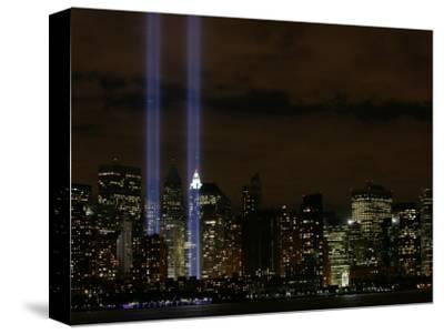 The Towers of Light Shine Over the Manhatten Skyline