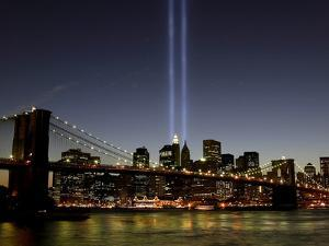 The Tribute of Light Memorial Shines into the Sky Over the Night Skyline of New York City