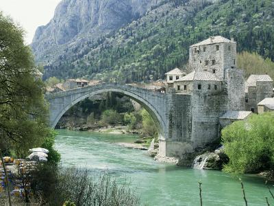 The Turkish Bridge Over the River Neretva Dividing the Town, Mostar, Bosnia, Bosnia-Herzegovina-Michael Short-Photographic Print